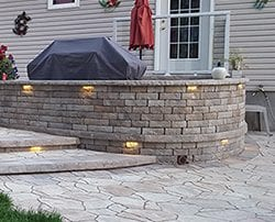 Outdoor kitchen built on a walled patio