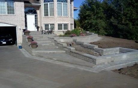 Elegant entrance stairway and multi-tiered garden under construction