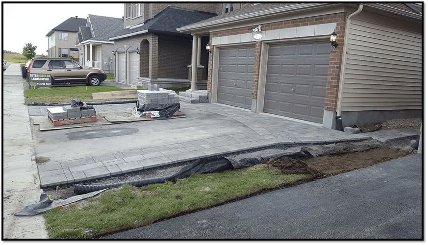 Gravel, fabric and paving installation
