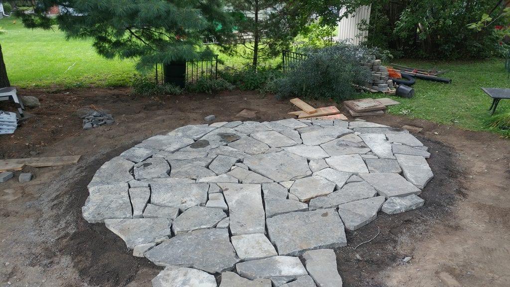 Natural stone circular patio under construction