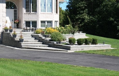 Elegant entrance stairway and multi-tiered garden