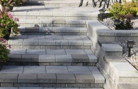 Elegant entrance stairway and multi-tiered garden