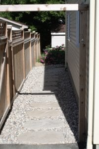 Side yard stone steps in gravel path