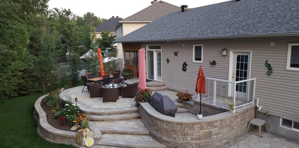 Curved patio with wide steps and a BBQ space