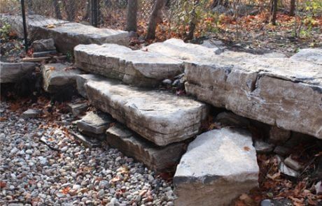 Natural stone wall fixture for elevated terrain