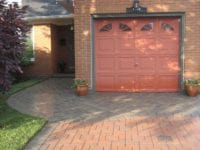 Driveway with a new paving stone walkway and inlay