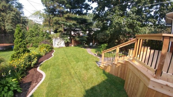 Deck, natural stone walkway and a new lawn