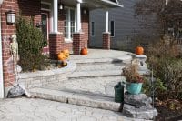 Tiered stonework walkway leading to front entrance of a house
