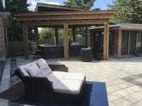 Roofed outdoor kitchen and pool patio
